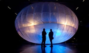 MDG : Visitors stand next to the Google Loon balloon, a high altitude Wi-Fi internet hub