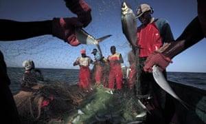 Canoe fishermen in the waters off of Dakar, Senegal