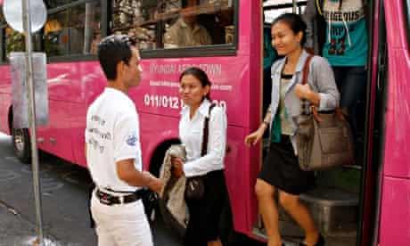 MDG : Passengers in Phnom Penh, Cambodia, disembark from a public bus