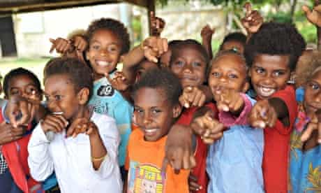 mdg : Tanna children showing a stained fingernail as proof of yaws treatment