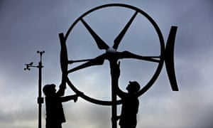 Green energies : Workers at Renewable Devices Swift Turbine, work on a wind turbine unit