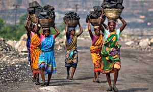 MDG : women carry coal taken from an open-cast field at Dhanbad district, Jharkhand