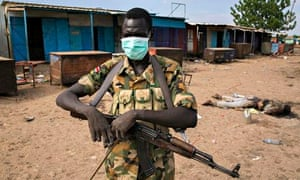 MDG : a rebel fighter stands in front of Kali-Ballee mosque, Bentiu, South Sudan