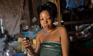 MDG : Lamola, 29, a sex worker at home in Kasensero.