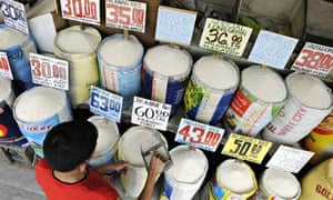 MDG : A shopkeeper displays different varieties of rice for sale at a market in Manila, Philippines