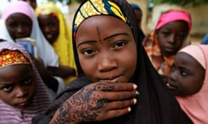 MDG : A schoolgirl displays a traditional henna design on her hand in Kano, Nigeria