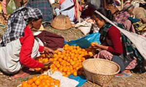 MDG A woman sells oranges at a bazaar in Meghalaya