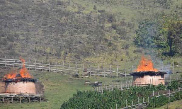 Homes of Sengwer people stand burning in Embobut, Kenya.