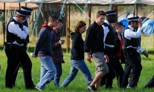 Police walk with protesters through the Heathrow climate change camp. Photograph: Fiona Hanson/Press Association