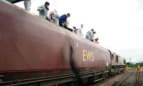 Activists throw coal from a train destined for Drax power station
