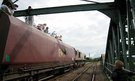 Activists halt a train on its way to Drax power station