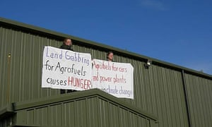 Protesters mount the roof at the European Biofuels Expo in Nottinghamshire