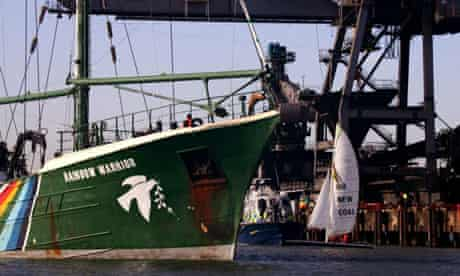 Activists from the Greenpeace flagship Rainbow Warrior enter the pier outside Kingsnorth power station in Medway, Kent