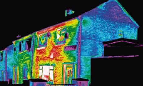 image photo of a badly insulated house, in which the white, red and yellow colour bands highlight significant heat loss