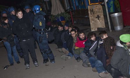 Policemen arrest activists after clashes at Christiania in Copenhagen