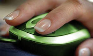 Womans hand using a green computer mouse