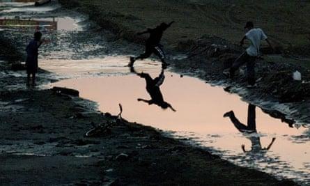 Water boys ... children play in a drought-shrunken Rio Grande