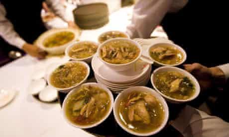 Shark fin soup is served at a wedding banquet