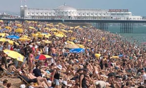 Crowded beach by the East Pier in Brighton
