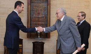 The UN-Arab League envoy, Lakhdar Brahimi, right, meets Syria's Bashar al-Assad