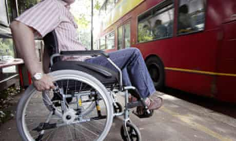 A disabled man at a London bus stop