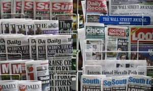 Newspapers are displayed outside a newsagent in London