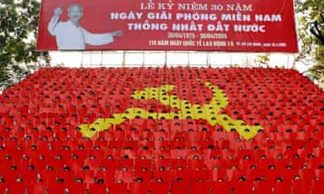 Vietnamese youths display the communist emblem during a parade in Ho Chi Minh City