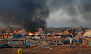 Moroccan forces dismantle the protest camp near Laayounce in 2010