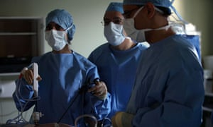 A surgeon and his theatre team perform surgery