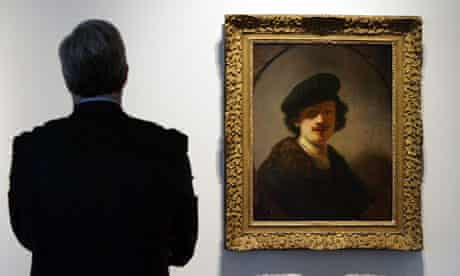 A man looks at a Rembrandt self-portrait dated 1634
