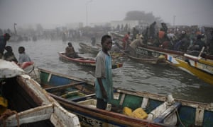 Senegalese fishermen returning from setting nets all night