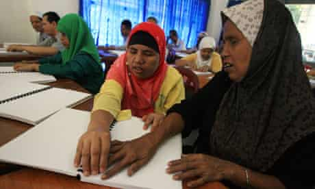 Blind People Read Koran in Braille