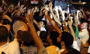 Supporters of Egypt's president, Mohamed Morsi, in front of  the presidential palace in Cairo