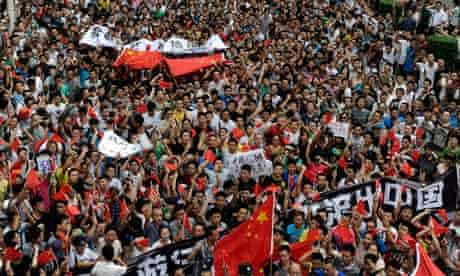 Protesters march in anti-Japan protest in Chengdu