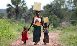 A mother and her children collect water in the Lira district of northern Uganda