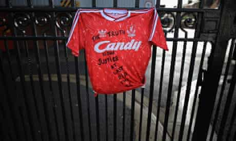 A Liverpool Football Club shirt is tied to the Shankly gates at Anfield stadium