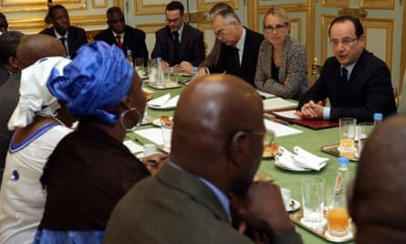 The French president, Francois Hollande, right, speaks with members of Malian associations in France