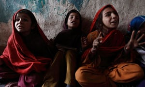 Girls attend class at a school in a slum on the outskirts of Islamabad in Pakistan