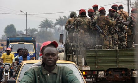 Central African soldiers patrol in an ar