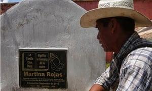 Mario Chen at the grave of his mother, Martina Rojas.