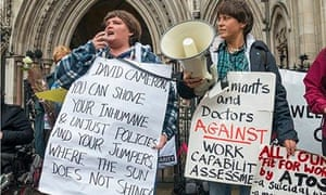 Disability activists attend a protest in London