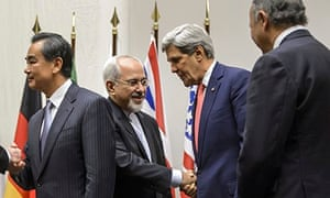 Mohammad Javad Zarif shakes hands with the US secretary of state, John Kerry,