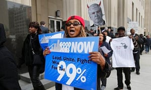 Protesters in Detroit, Michigan, rally against cuts.