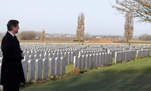David Cameron at the graves of first world war soldiers in Tyne Cot cemetery in Zonnebeke, Belgium