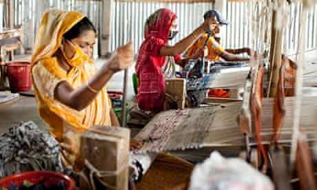 Women work in a rug factory in Bangladesh