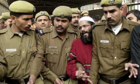 Police bring Afzal Guru to court in Delhi in 2002