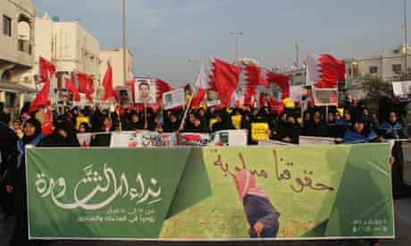 Women march in Bahrain to mark the second anniversary of the uprising