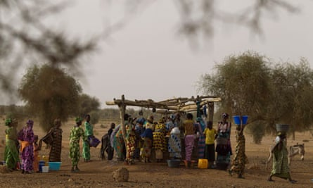 Women crowd around a well in the Matam region of north-eastern Senegal