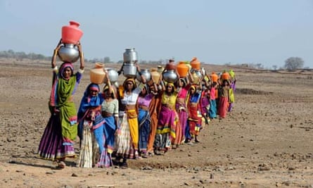 Indian women carry drinking water in the Medak district of Andhra Pradesh