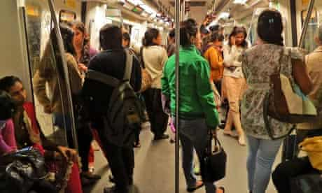 Indian women travel inside a 'women only' metro train compartment in Delhi